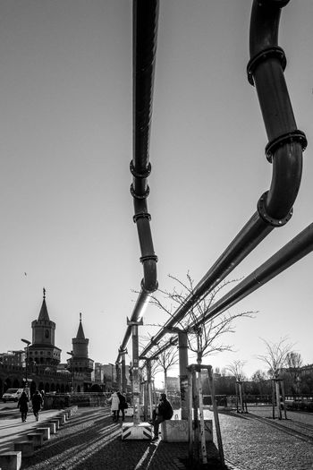 Clear Sky Building Exterior Built Structure Outdoors Transportation Architecture Sky Day City Travel Destinations Bridge - Man Made Structure Real People Suspension Bridge Capture Berlin Berlin Pipeline Germany Pipes Streetphotography Candid Monochrome Blackandwhite The Street Photographer - 2017 EyeEm Awards The Architect - 2017 EyeEm Awards