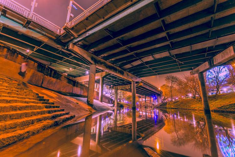 High angle view of illuminated bridge in water at night