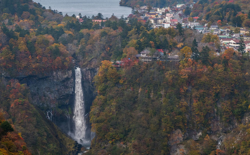 Houses by kegon falls during autumn