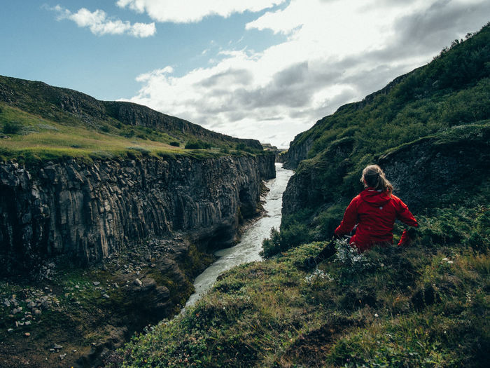 Iceland Adventure Beauty In Nature Canyon Cliff Day Full Length Hiking Landscape Leisure Activity Mountain Nature One Person Outdoors Real People Rear View Red Rock - Object Scenics Sky Tree Waterfall Young Adult Young Women