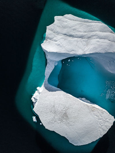 High Angle View Of Iceberg In Sea During Winter