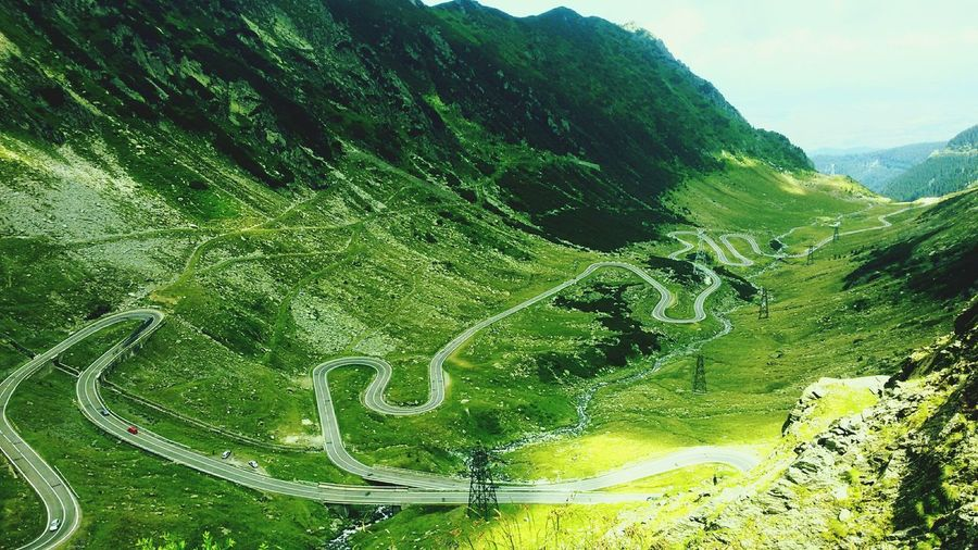 Green Color Mountain Tree Nature Day Beauty In Nature No People Outdoors Growth Sky Transfagaraşan Green Grass 🌱 Clear Sky Blue Sky Cloud - Sky Reflection Tree Area Plant Leaf Tree Nature Green Color Road Love That Moment Fragility