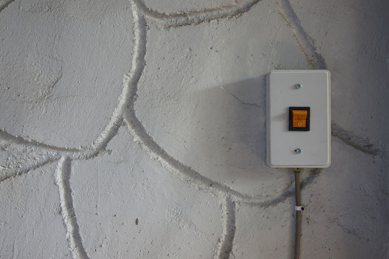 Electric switch mounted on wall