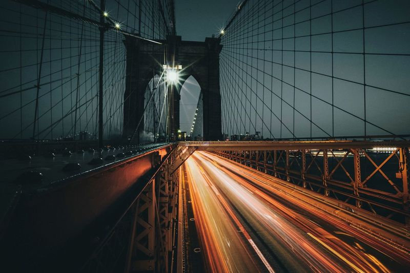 Light Trails On Suspension Bridge At Night