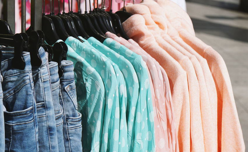 Retail  Shopping For Sale Store Coathanger Collection Rack Clothing Retail Display Clothing Store Sale No People Fashion Consumerism Boutique Clothes Ladieswear Womenswear Pastel Colored Casual Clothing Jeans Denim Sweater Outside Spring
