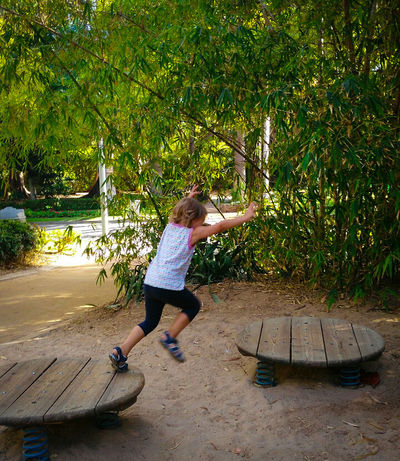 Carefree Vitality Nature Happiness Outdoors Childhood Enjoyment Green Color Jumping Child