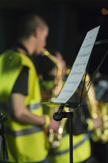 Brazzobrazzie festival. Brass Band Brazzobrazzie Festival Close-up Festival Festival Season Focus On Foreground Green Color Illuminated Lifestyles Live Music Music Notes Part Of Play Saxophone Selective Focus