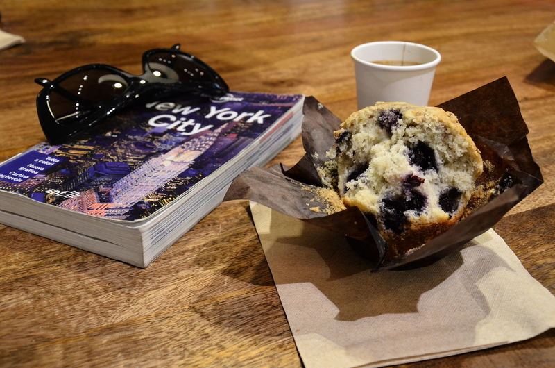 High angle view of dessert by book with text on table