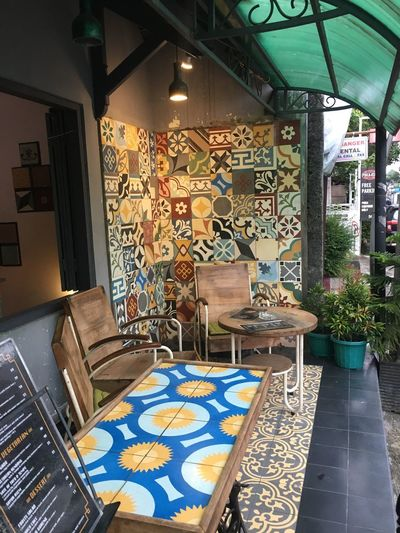 Cafe INDONESIA Yogyakarta Jogjakarta Jogja Mismatched Tiles Tiled Wall Design Indoors  Lighting Equipment Business No People Illuminated Architecture Pattern Small Business Store Built Structure Seat Creativity Table Chair Decoration