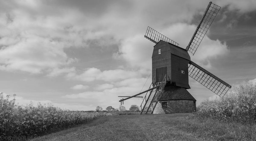 Wind Power Alternative Energy Renewable Energy Wind Turbine Field Windmill Environmental Conservation Traditional Windmill Sky Cloud - Sky Rural Scene Fuel And Power Generation Day Outdoors Nature No People Grass Technology Industrial Windmill Architecture