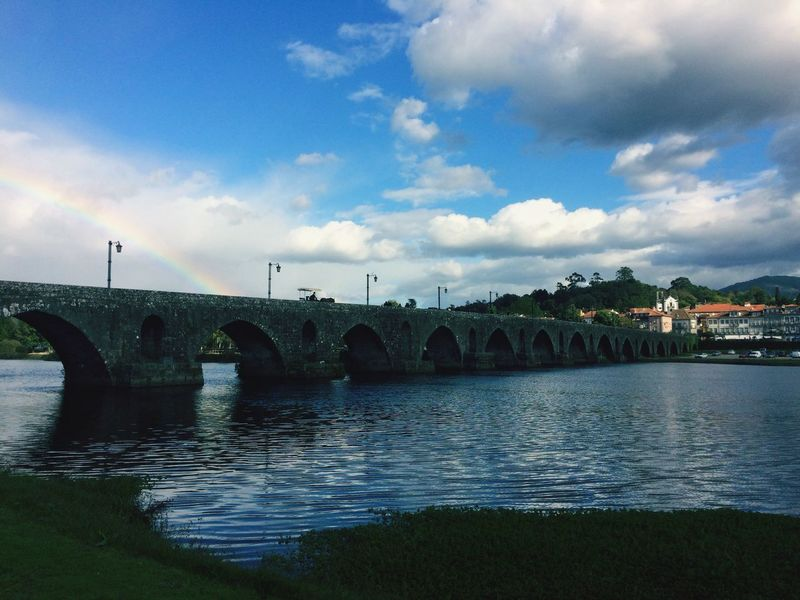 rainbow Water Bridge - Man Made Structure Ponte De Lima Ponte Sky Sky And Clouds River Clouds & Sky Clouds Built Structure Grass Outdoors Day Nature Riverbank Connection Beauty In Nature Light Effect Light And Shadow EyeEmNewHere Connected By Travel