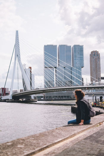 Architecture Built Structure Water Bridge Sky Bridge - Man Made Structure Transportation One Person Real People City Building Exterior River Connection Lifestyles Leisure Activity Day Nature Sitting Outdoors Office Building Exterior Skyscraper Modern EyeEm Best Shots EyeEmNewHere EyeEm Selects