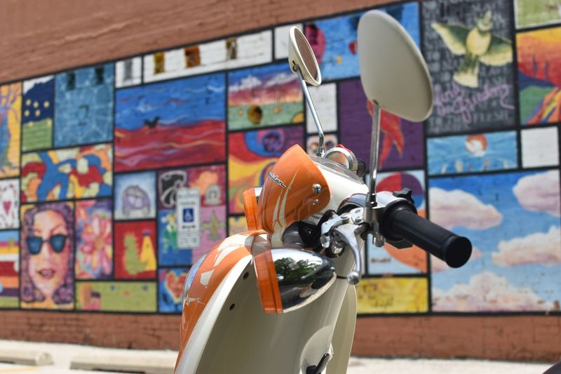 Scooter and urban art Scooter Creativity Art And Craft Focus On Foreground Graffiti No People Multi Colored Metal Wall - Building Feature Close-up Outdoors Representation
