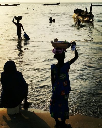 Taking Photos Hello World Working Beachlife The Gambia Fishermen Boats Sea And Sky Beach Girl Woman Shadows & Lights Birds Working Hard Investing In Quality Of Life