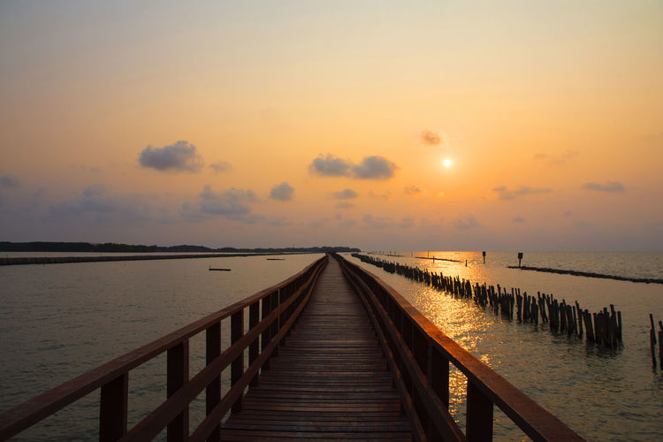 Sky Water Sunset Scenics - Nature Tranquil Scene Sea Tranquility Beauty In Nature Railing Horizon Over Water Horizon Orange Color Nature The Way Forward Pier Wood - Material Direction No People Idyllic Diminishing Perspective Sun Outdoors Long Landscape Seascape Red Bridge Samut Sakhon Thailand Travel Background Nature Morning
