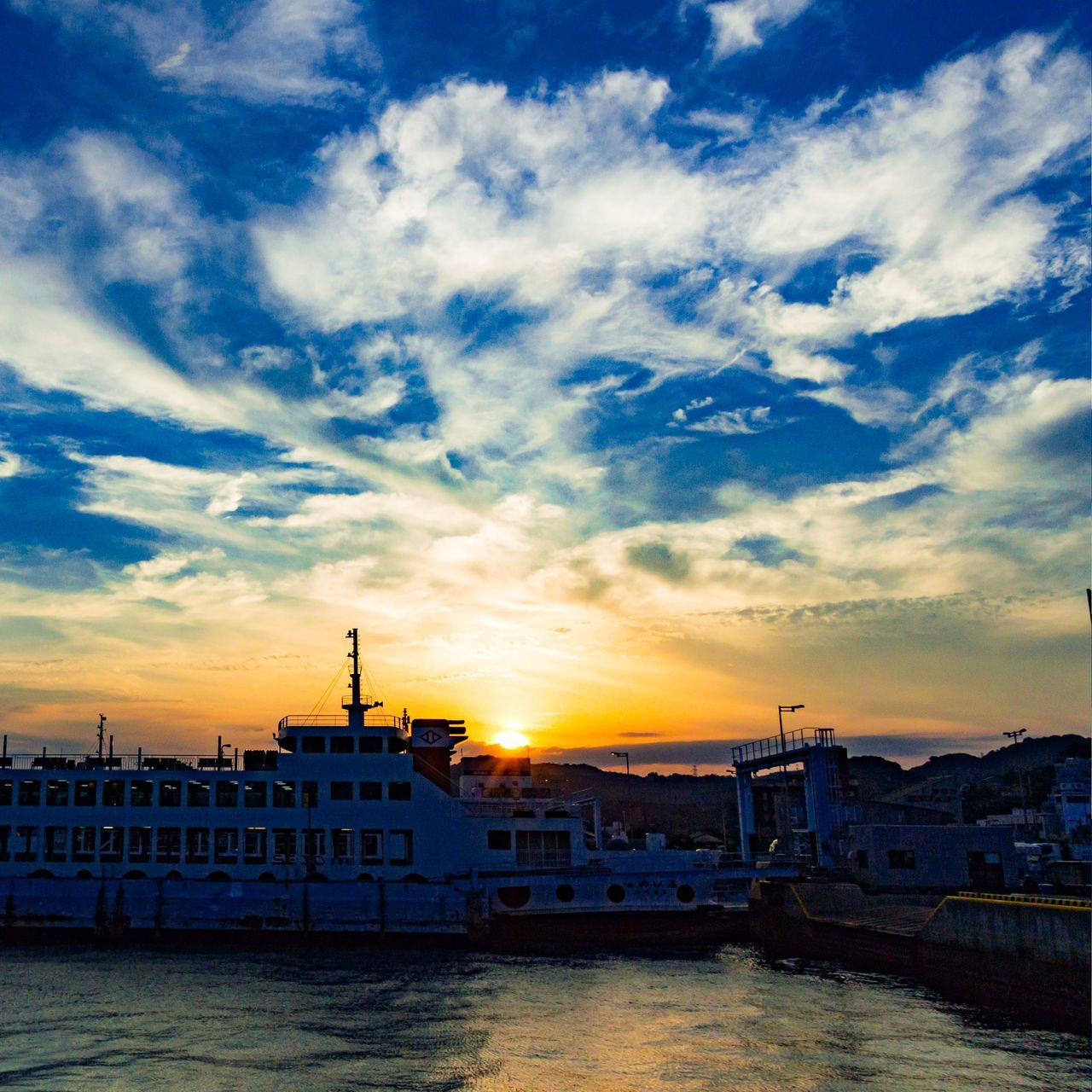 water, building exterior, architecture, sky, cloud - sky, built structure, nautical vessel, sunset, sea, no people, waterfront, outdoors, travel destinations, nature, moored, beauty in nature, harbor, city, cityscape, yacht, day