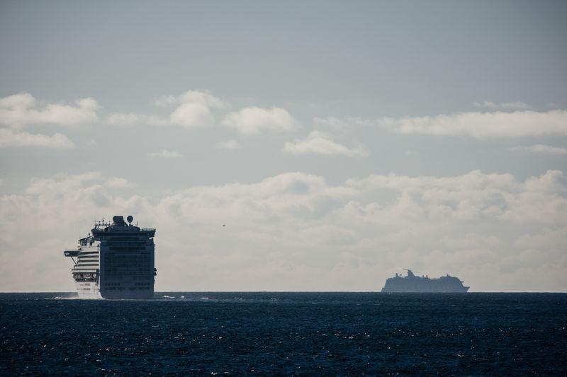 Ships In Calm Sea Against Clouds