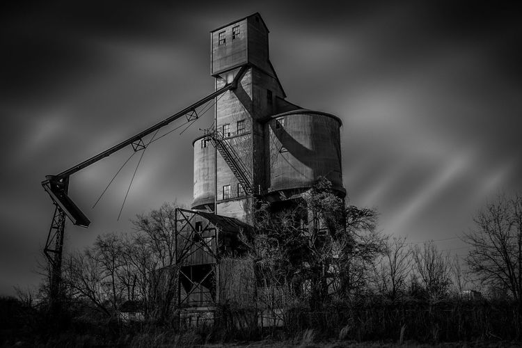 Old Railroad Grain Loader B&W w Complex Lighting Abandoned Architecture Bare Tree Building Exterior Built Structure Clear Sky Communications Tower Day Destruction Environmental Conservation Factory Industry Low Angle View No People Outdoors Ruined Street Light Structure Tower