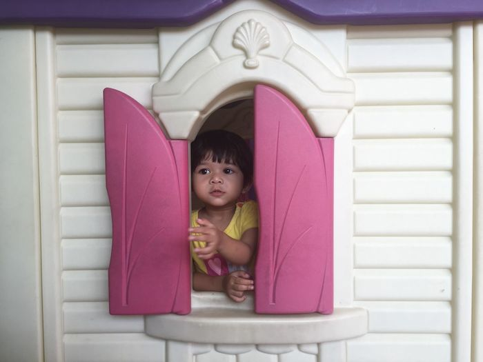 A Child Playing Millennial Pink Baby Childhood Close-up Cute Day Headshot Indoors  Innocence Lifestyles Looking At Camera One Person People Pink Color Pink Window Real People The Portraitist - 2018 EyeEm Awards