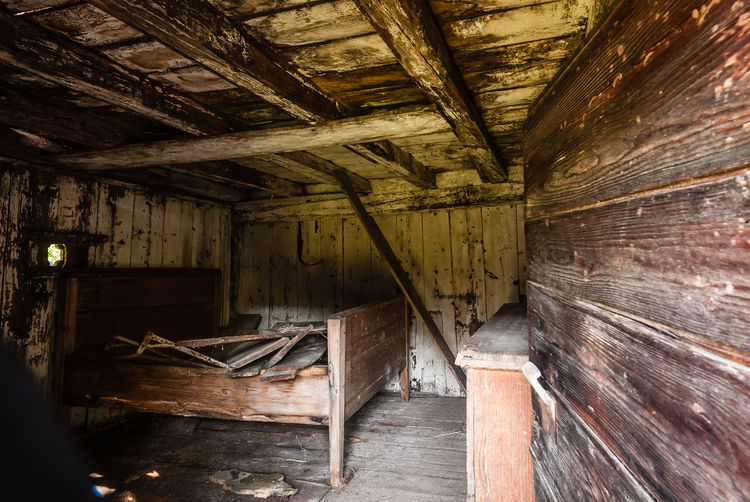 Abandoned interior with wooden ceiling