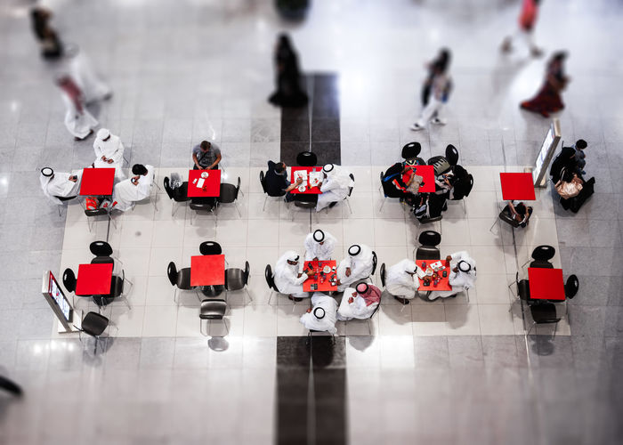 Coffee Tilt-shift UAE Chatting High Angle View In A Row Indoors  Leisure Activity Mall National Dress Red Representation Selective Focus Table