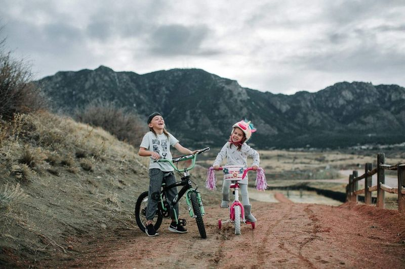 Sibling bikers Bicycle Happiness Child Childhood Two People Girls Full Length Fun Riding Togetherness Mountain Cheerful Outdoors Leisure Activity Adventure Smiling Cycling Bonding Cloud - Sky Females