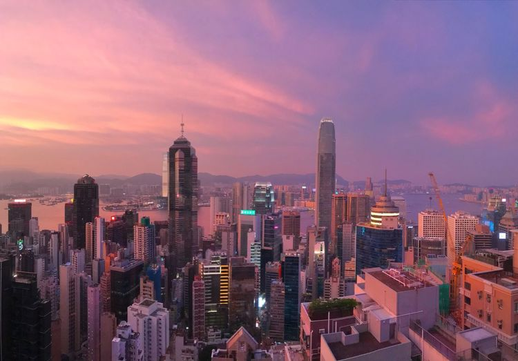 Evening sky over Hong Kong Travel Destinations Hong Kong Building Exterior Built Structure Office Building Exterior Architecture Skyscraper Building City Cityscape Sky Sunset Tall - High Modern Downtown District City Life Illuminated Urban Skyline The Traveler - 2018 EyeEm Awards