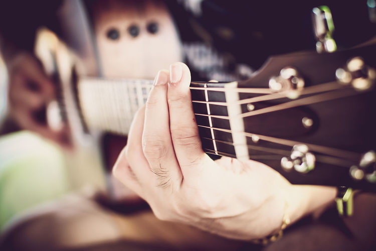 man hand playing the guitar Acoustic Guitar Arts Culture And Entertainment Close-up Day Electric Guitar Fretboard Guitar Human Body Part Human Hand Indoors  Man Hand Playing The Guitar Music Musical Instrument Musical Instrument String Musician One Person People Playing Plucking An Instrument Real People Selective Focus