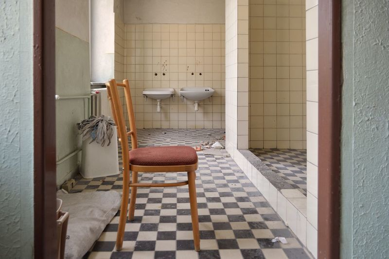 Empty chair in bathroom