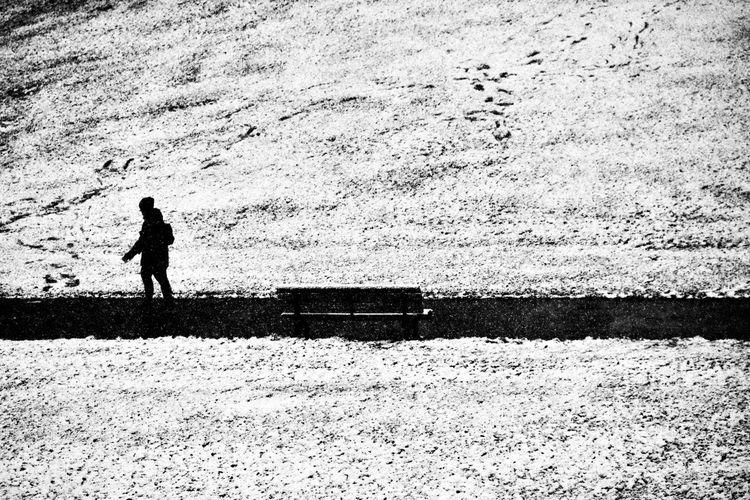 Silhouette woman standing on field