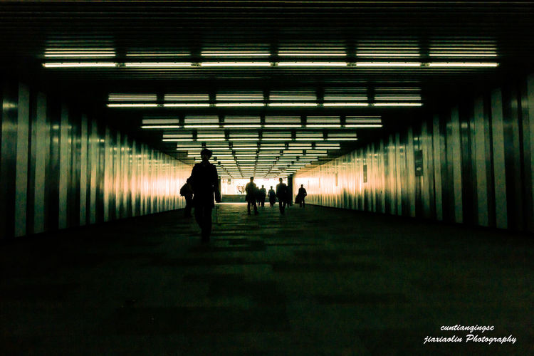 Men in tunnel