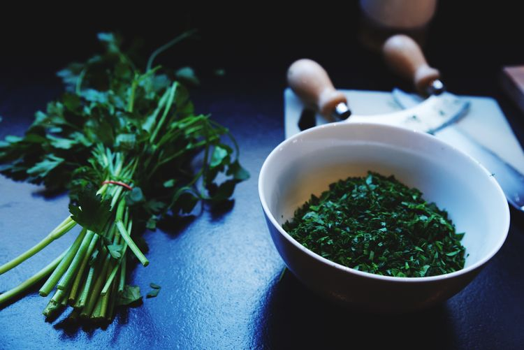 High angle view of cilantro on table