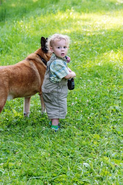 A boy and his dog Family Child Childhood Grass Plant Mammal One Person Animal Themes Green Color Full Length One Animal Domestic Real People Pets Cute Nature Domestic Animals Innocence Field Animal