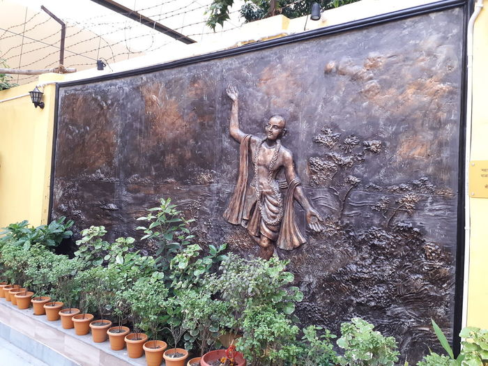 Statue of potted plants outside building
