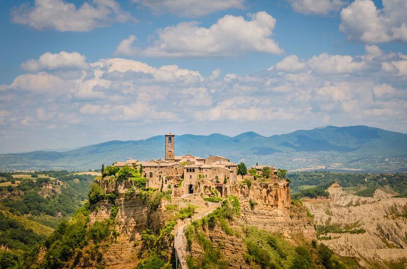 Castle on mountain against blue sky