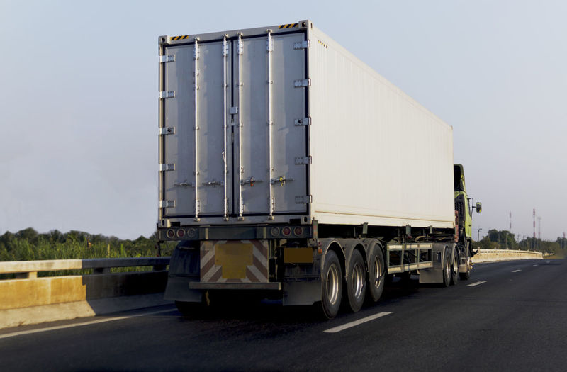 Transport Business Commercial Land Vehicle Container Day Freight Transportation Industry Land Vehicle Large Mode Of Transportation Motion Nature No People Outdoors Road Semi-truck Sky Transportation Truck Trucking Vehicle Trailer Wheel