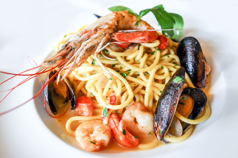 Close-Up Of Pasta With Clams And Shrimp Served In Plate