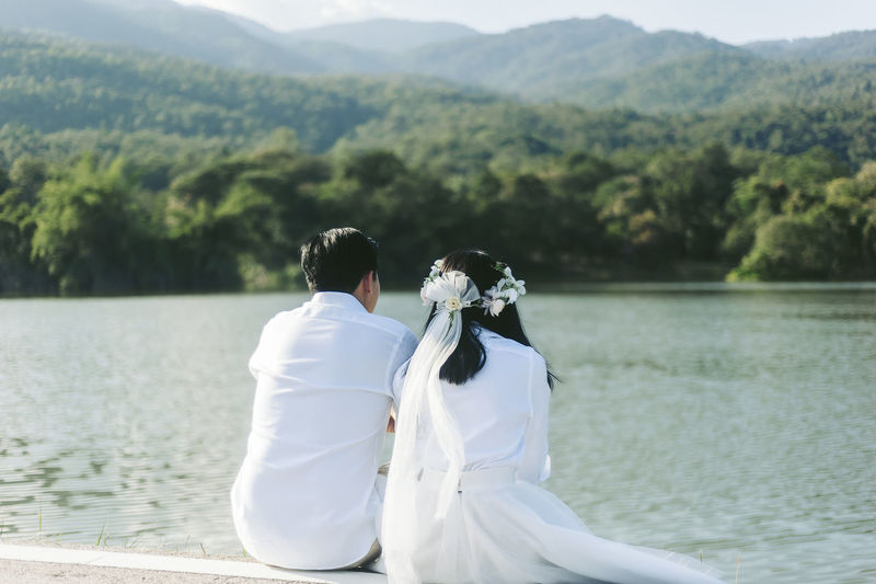 Rear view of couple kissing in lake