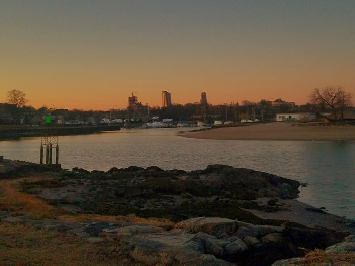 A gorgeous and calm sunset at Glen Island Park, New Rochelle (3/18/2018) Orange Color Boulders City Cityscape Urban Skyline Water Sunset Skyscraper Low Tide Tranquil Scene Scenics Calm