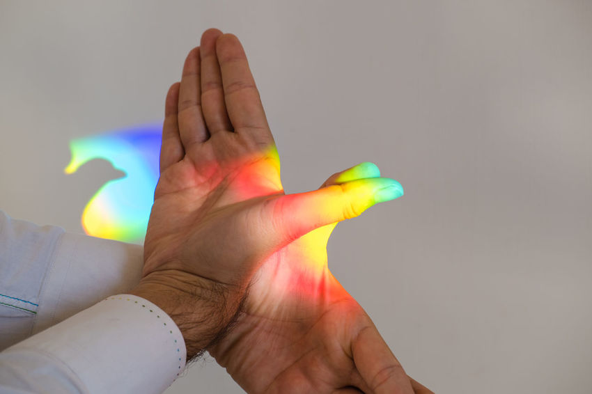 Man Making hand shadow of a bird. Chinese Shadows Light Peace Rainbow Colors Bird Concept Conceptual Image Conceptual Photography  Holding Human Body Part Human Finger Human Hand Indoors  Lifestyles Multi Colored One Person People Rainbow Real People Reinbow Colors Shadow Symbol Rethink Things