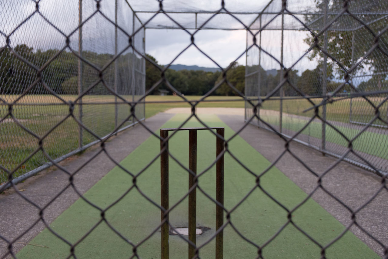 SCENIC VIEW OF FIELD SEEN THROUGH FENCE
