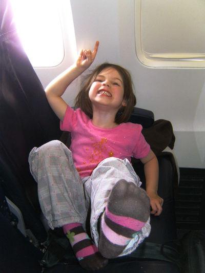 Smiling girl sitting in bus
