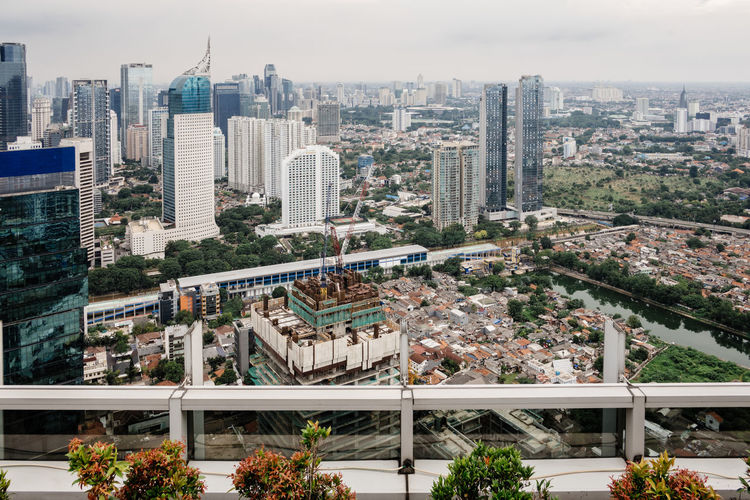 High angle view of modern buildings against sky