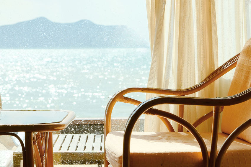 Tropical Seaview Through Window Relaxing Resort Hotel Seaview Beach Beach Beauty In Nature Chair Close-up Curtain Day Hotel View Luxury Nature No People Relax Relaxation Relaxing Moments Relaxing Time Scenics Sea Sky Table Water