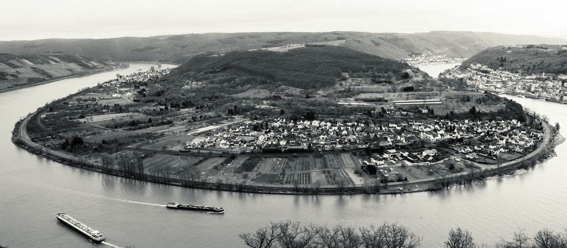 """Beautiful view over the """"Rheinschleife"""" Travel Destinations Taking Photos Wide Angle River Germany Rhine Landscape EyeEm Best Shots Monochrome Blackandwhite Panoramic Panorama High Angle View Aerial View Architecture Outdoors Day Built Structure Building Exterior City Cityscape No People Water Tree Sky"""