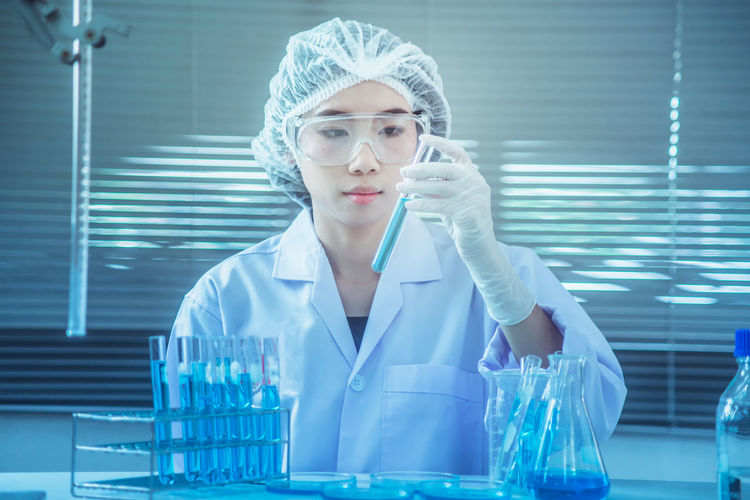 Scientist Working At Table In Laboratory