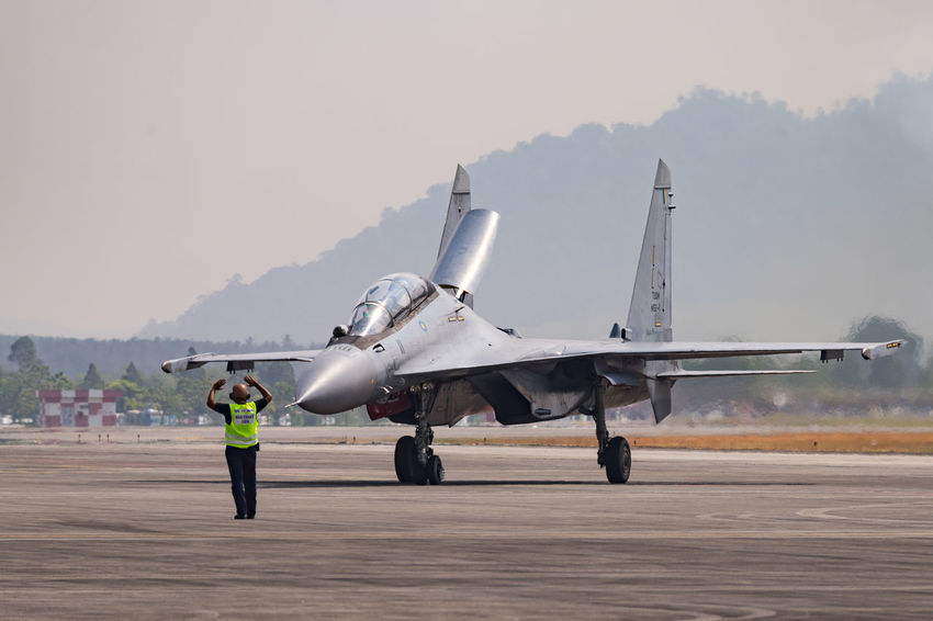 Team Royal Malaysia Air Force from Malaysia with aircraft Mikoyan MiG-29 during LIMA 2015 in Langkawi, Malaysia. Malaysia Truly Asia Mig-29 Air Force Air Vehicle Airplane Airport Runway Clear Sky Day Fighter Plane Lima2015 Men Mountain Nature One Person Outdoors People Real People Sky Transportation