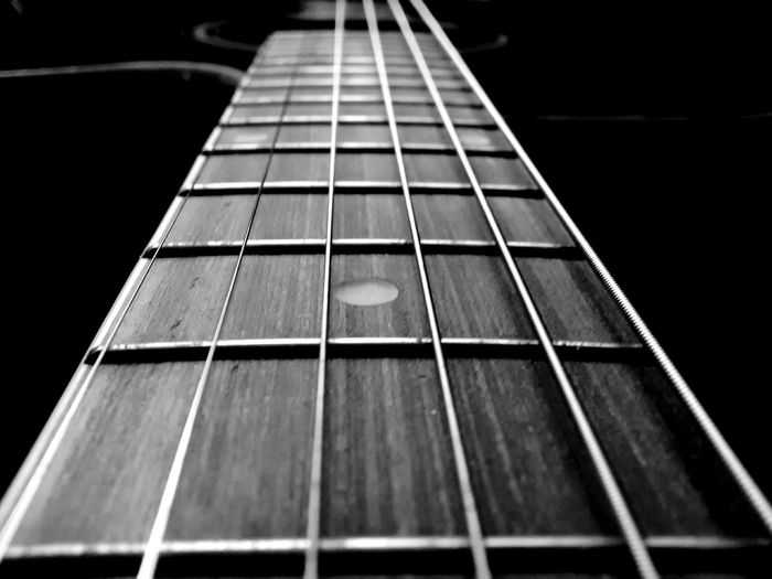 Guitar strings. EyeEm Selects Guitar Strings Black & White Blackandwhite Mobilephotography PhonePhotography Black Background Fretboard Guitar Musical Instrument String Musical Instrument Classical Guitar Classical Music Music Arts Culture And Entertainment Woodwind Instrument Jazz Music Classical Musician Desaturated Brass Instrument  Single Object