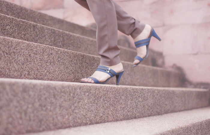 Working women wearing high heels, walking up the stairs. Day Focus On Foreground Foot Wear  Footwear High Heels Lifestyles Part Of Pink Color Selective Focus Shoes Stairs Up Stairs Walk Working Woman First Eyeem Photo