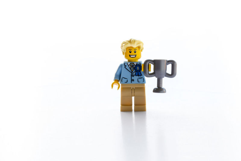 And the winner is... Human Representation Toy Studio Shot Male Likeness White Background No People Communication Copy Space Still Life Fun Figurine  Single Object And The Winner Is ... Winner Winning First LEGO Celebration Cup Winners First Place  1 Editorial